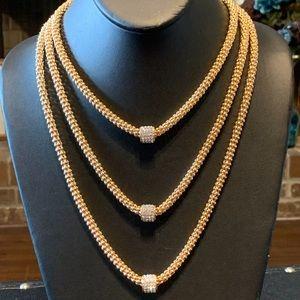 NWT triple strand gold tone rhinestone necklace